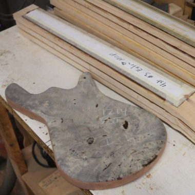body of unfinished Spector bass in workshop