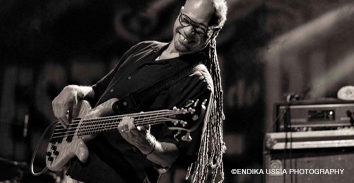 Lenny Bradford playing bass in concert