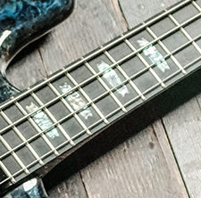 closeup of position markers on fretboard