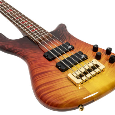 body of orange and yellow Spector bass