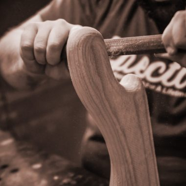hands shaping piece of wood