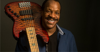 artist, Tony Hall, holding Spector electric bass