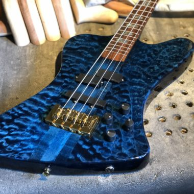 closeup of body of blue Spector electric bass