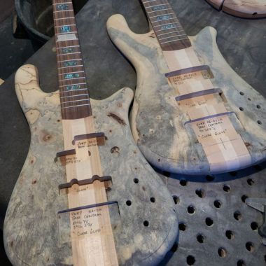 two unfinished Spector basses in workshop